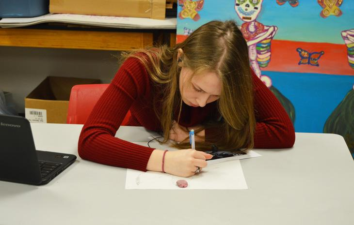 Junior Kristina Green draws in her art class during third period on Feb. 2. As of right now, Green doesn't have any specific ideas or plans for what she wants to do in the future, but she hopes it includes supporting her passion.