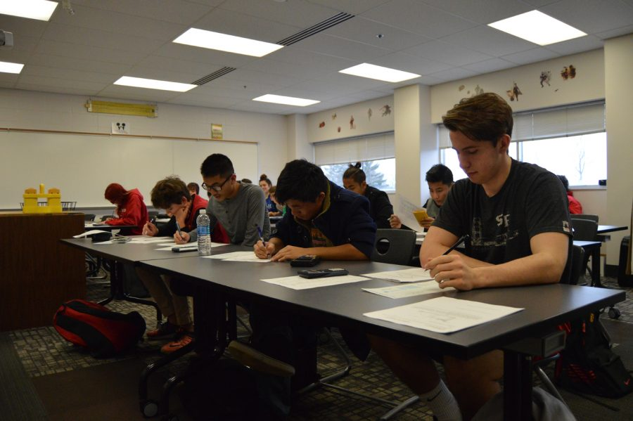 Students take a test in physics teacher Stacey Matlock's room. Sophomores have to take five standardized tests, and sophomore Burmese students have to take a total of six. within the course of the school year.