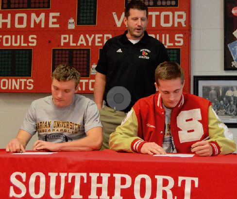 Seniors Andrew Mappes (left) and Hunter Hightower (right) sign their national letters of intent to play football at Marian University. They will join three other SHS alumni on the Marian football team next year.