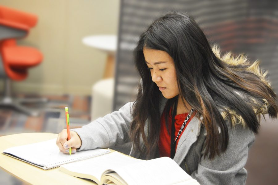 SHS graduate Tial Par works on an assignment on March 13 at Butler. Par expected college to be easier because it somewhat reflected her high school education.
