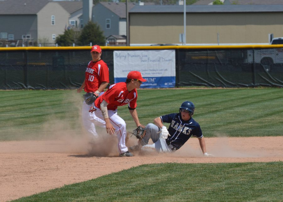 Freshman+Ryan+Lezon+attempts+to+get+a+Decatur+Central+player+out+at+second+base.+The+runner+was+ruled+safe.+