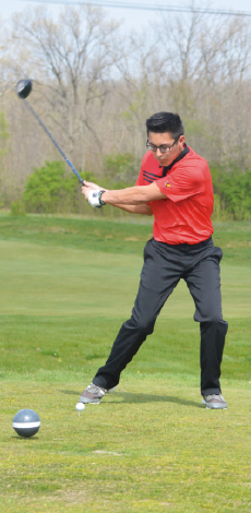 Junior Davis Chan drives the ball during a match against Beech Grove on April 13. Chan had a score of 42 which is six above par.
