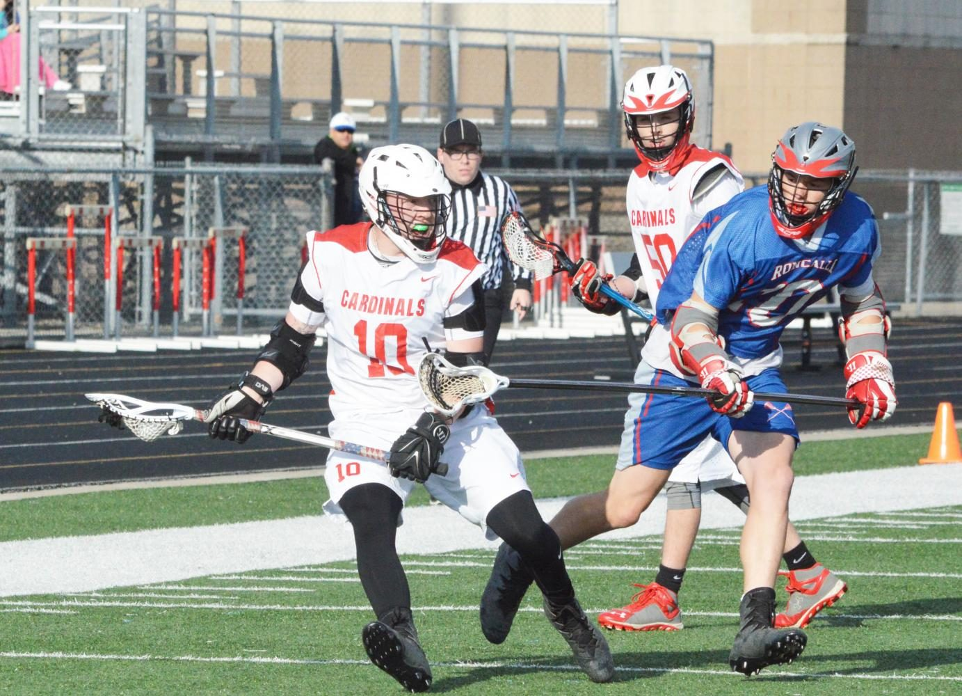 Junior Dayton Fries cradles the ball as he runs down the field on Friday, May 5 against the Roncalli Rebels.