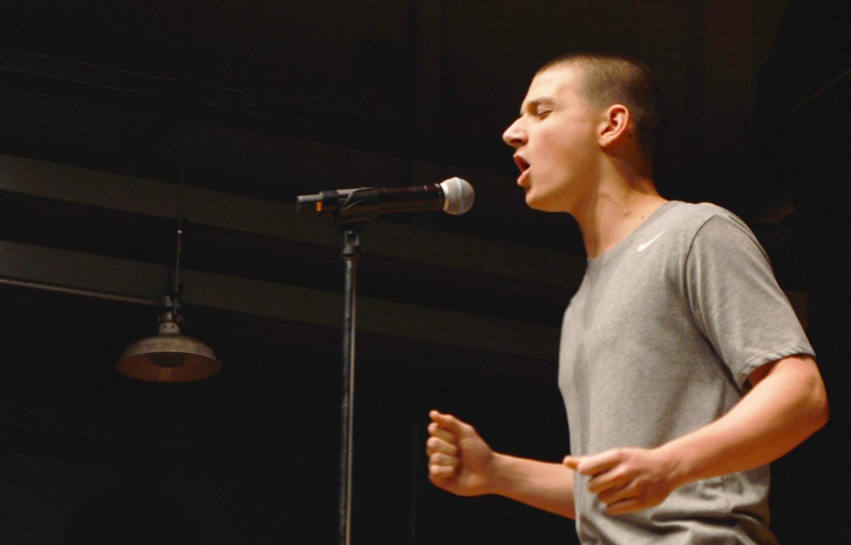 Freshman Justin Tidd sang