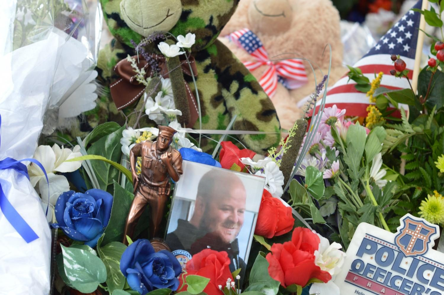 The memorial for Lt. Allan's memory on Tuesday, August 1. The community began contributing items such as letters, candles, teddy bears and flowers on Thursday and have continued to do so in the following days.