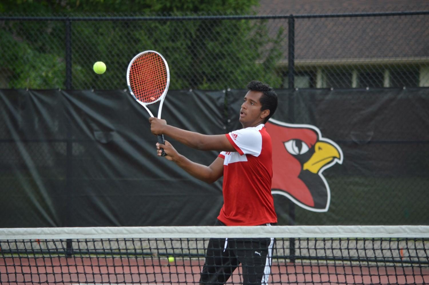 Senior Seejay Patel swings at the ball during a practice.
