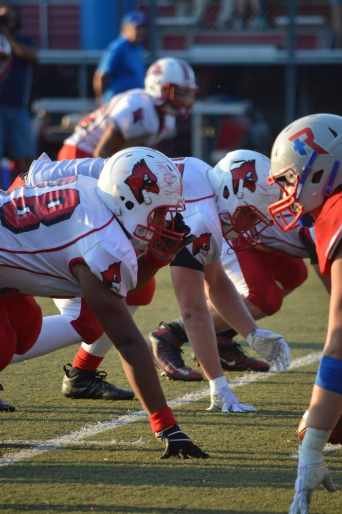 The Cards' defensive line prepare to go against Roncalli on Aug. 18.