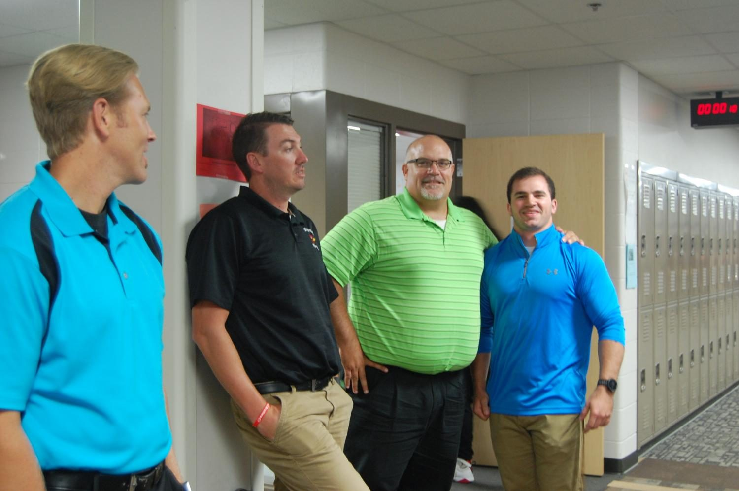 Social studies teachers Tyler Weatherford (left front), Ethan Braun (front right), Gene Lezon (left back) and Cody Braun (right back) are four social studies teachers who share a bond.