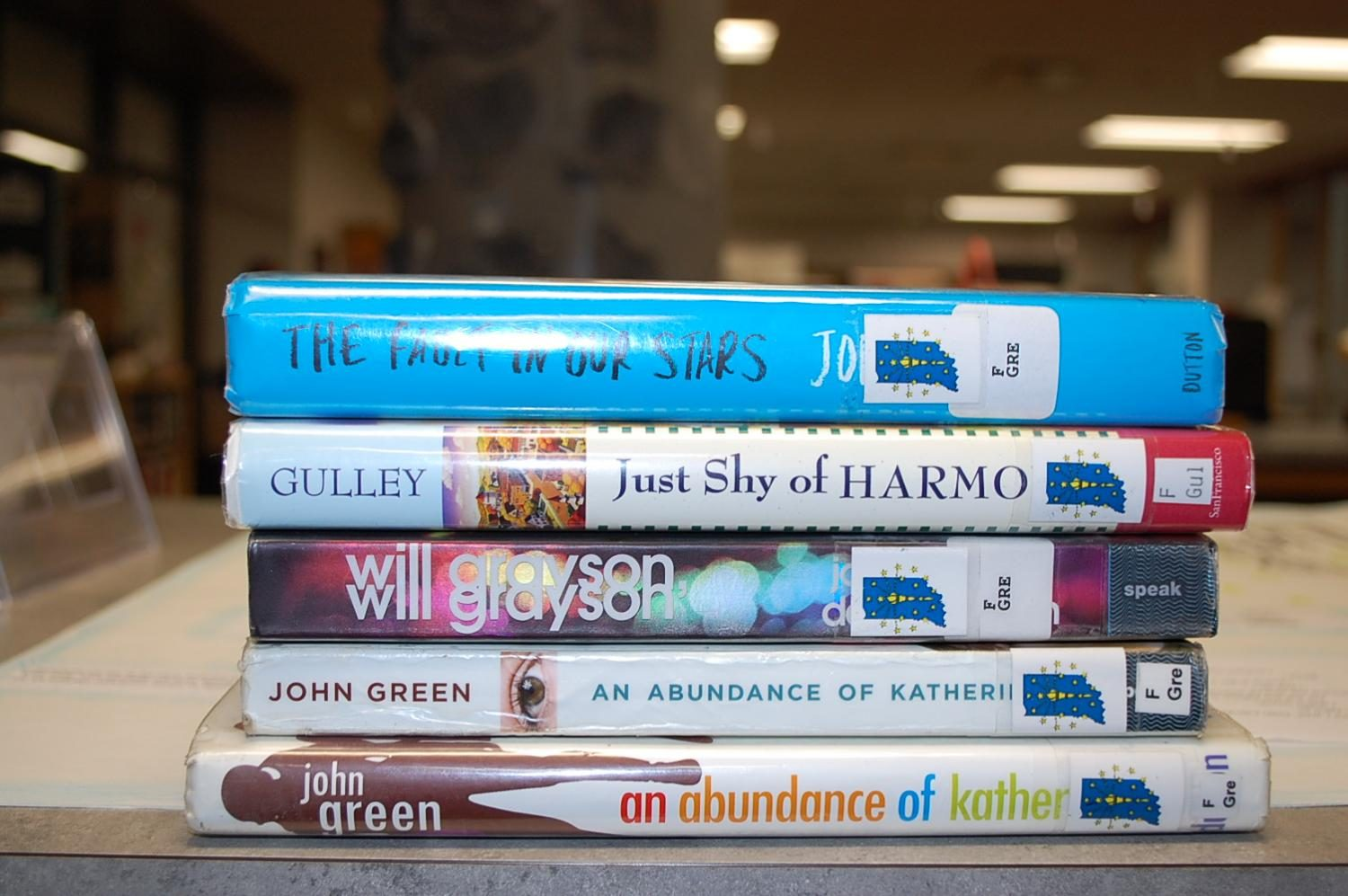 Two+local+authors%2C+John+Green+and+Phillip+Gulley%2C+have+their+book+on+display+at+the+SHS+library.
