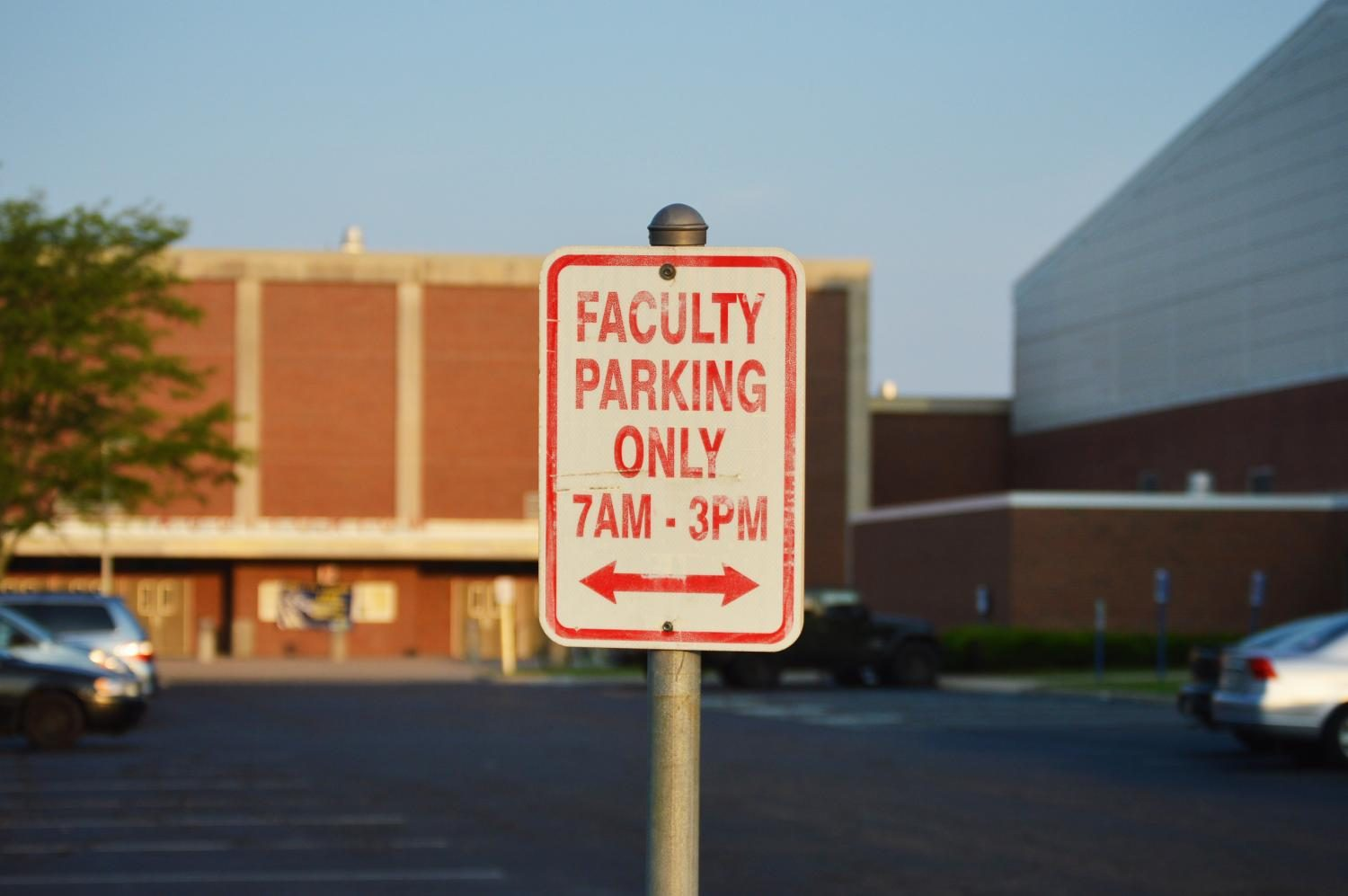 Faculty parking sign shows time and place at which only staff can park.