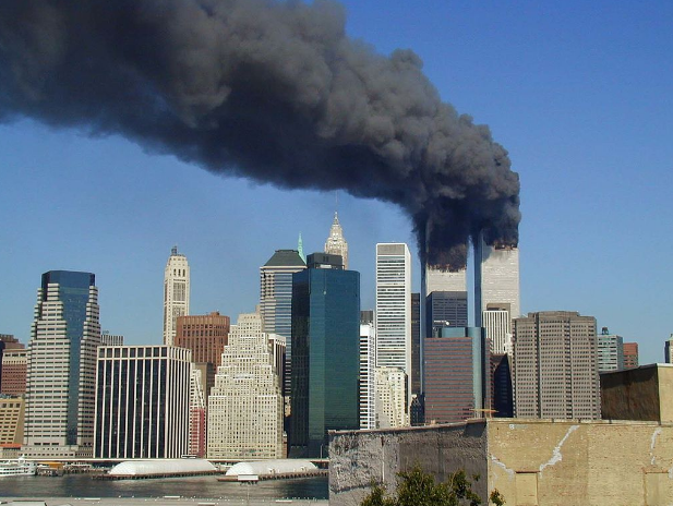 Smoke comes out of the twin towers shortly before the first one collapsed at 9:03 a.m. The city was covered in smoke and rubble.