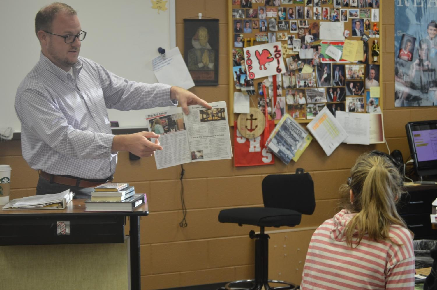 English Teacher Sam Hanley teaches about the truthfulness of the Satire section to his Honors English Class.