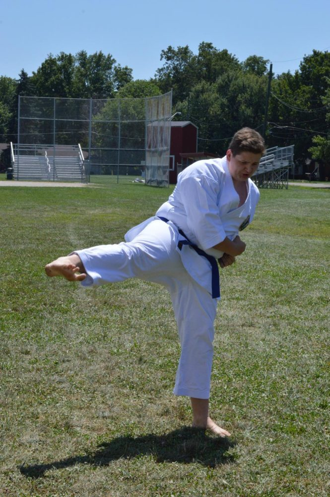 Junior Nathan Miller practiced his karate routine. Miller ranked up from a blue belt to a green belt that night at a ranking test.Miller says he hopes to continue to grow through karate and advance through the different levels all to better himself.