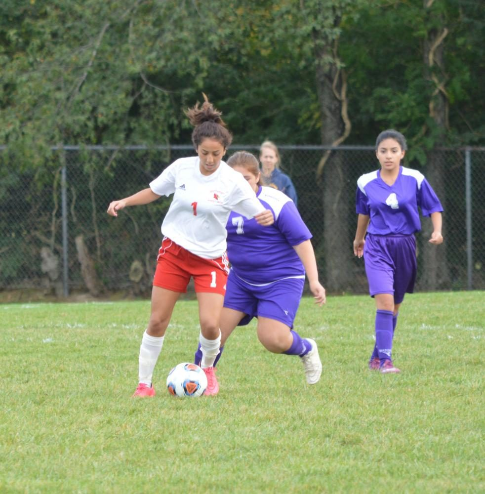 Senior Yaritzi Salazar dribbles the ball away from a Washington high School defender. Salazar has been on the team since her freshman year.