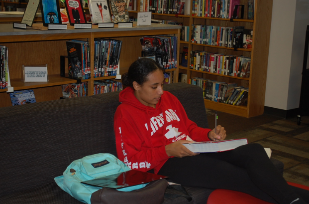 Junior Karina Bugarin reads while relaxing in the IMC.