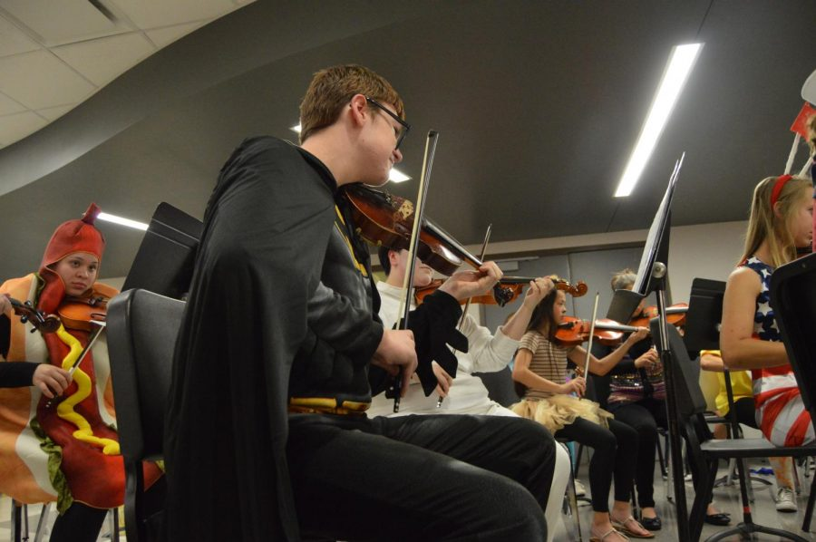 Sophomore+David+Massengale+plays+his+violin+while+dressed+as+Batman+at+the+Halloween+concert+on+Oct.+26.+