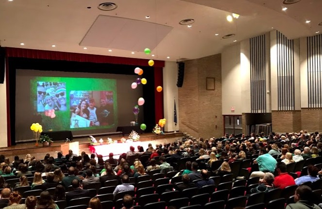 Balloons fall during a final presentation at Woodward's celebration of life. At the memorial, friends, family and students spoke to honor her.