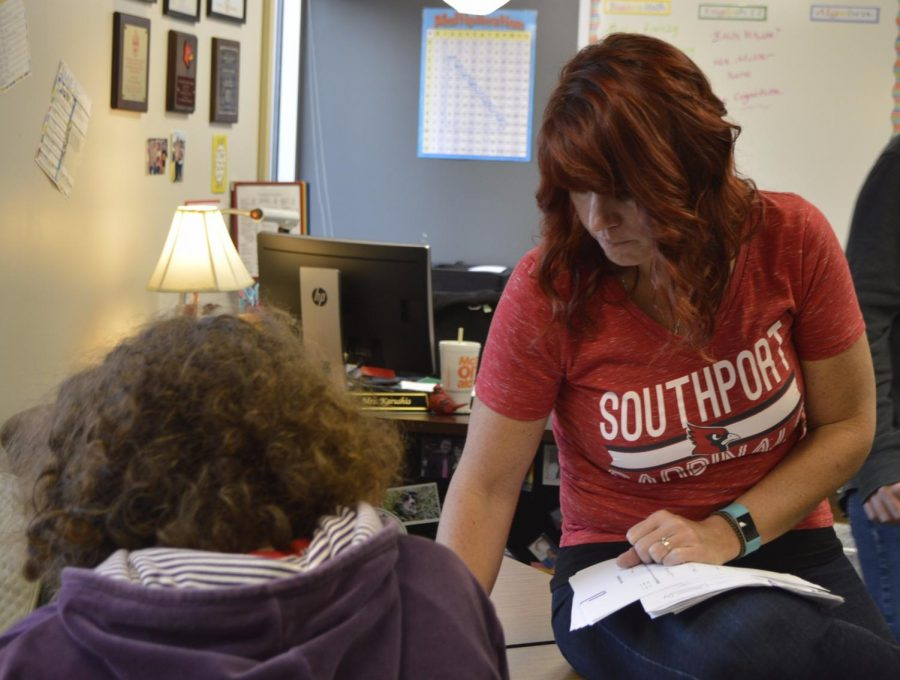 Exceptional needs teacher Jennifer Karushis works with her students in block RW2 on Nov. 3.