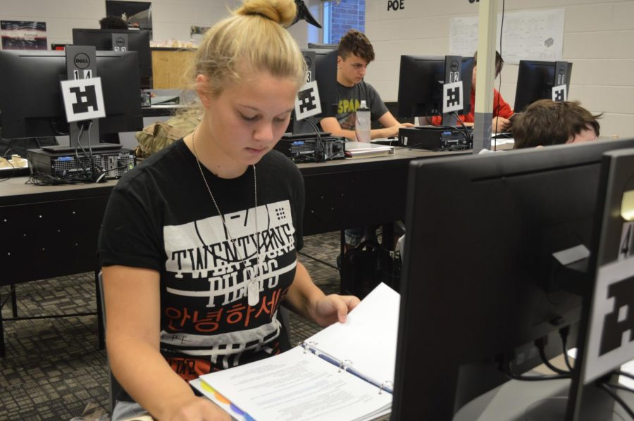 Junior Melissa Bushong works during engineering class as the only female in the room.