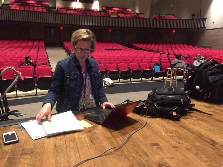 Theater teacher Kimberly Roberts takes attendance during her tech theater class.