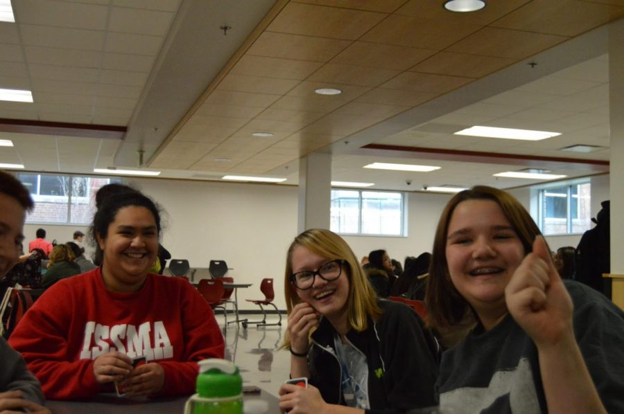 "Sophomores [left to right] Lesley Ebeyer, Riley Richter and Sarah Rusaw laugh during a game of Uno at lunch. Ebeyer, Richter and Rusaw all have either depression, anxiety or both. One way they try and deal with the tendencies of their illnesses is by playing a modified game of Uno in which players must pick up cards if they say ""kill myself"" or ""kill yourself""."