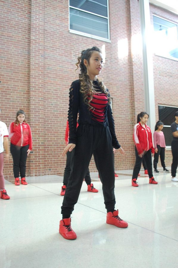 On+Nov.+30%2C+senior+Yuke+Yu+dances+during+dance+practice.+Yu%27s+coach+Heather+Todero+says+Yu+used+to+be+very+shy%2C+but+now+she+is+unafraid+to+try+new+dances.+She+says+because+of+this%2C+Yu+sets+an+example+for+younger+teammates+and+leads+them+when+they+need+help.+