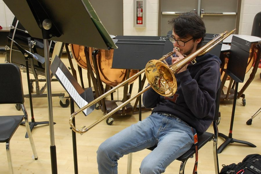 senior Zephaniah McCool plays the trombone during his jazz band class.