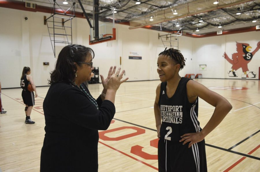 Junior Markayla Scott (right) signs with her interpreter, Patty Sorrell, at a practice on Dec. 12.