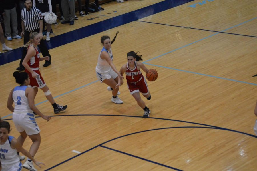 Senior Andrea Vidaurre drives to the paint against Perry Meridian. SHS lost the game 55-52.