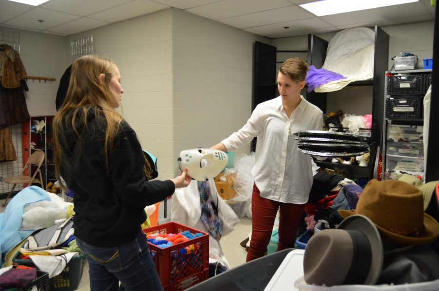 Senior Kristina Green and theater assistant Elisa Deardorff organize the costume room.