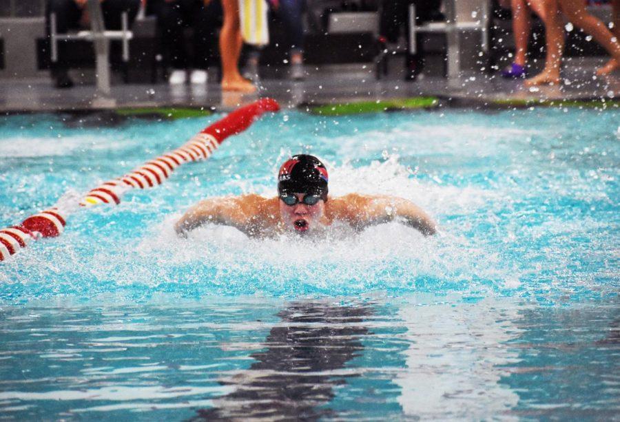 Senior Scott Speiser swims the butterfly stroke in the Medley Relay against Greenwood's swim team on Tuesday, Jan. 9.