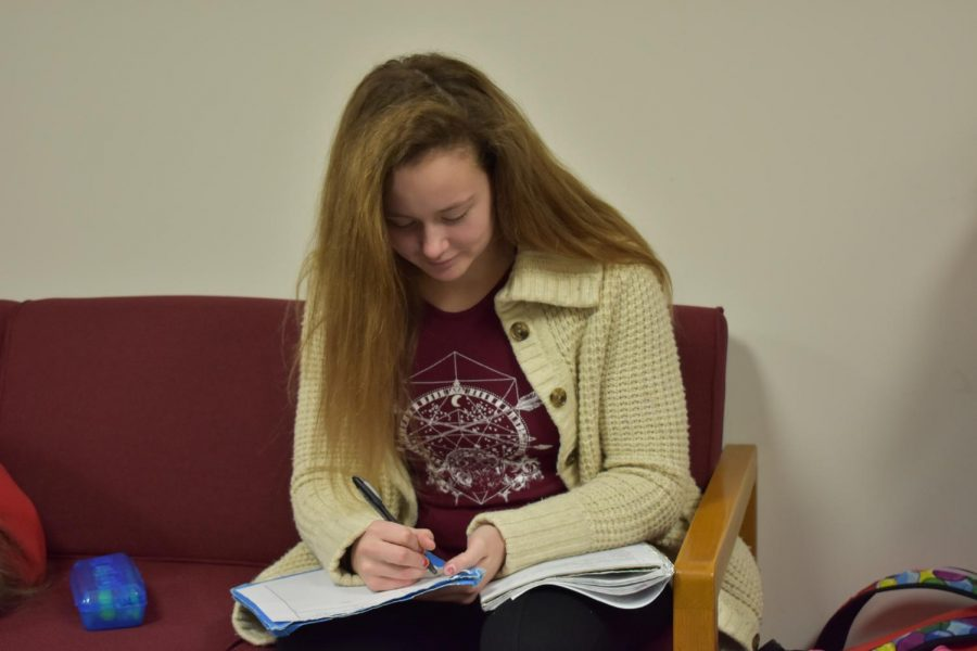 Junior Makenzie Lukas works on homework in the copy room during her study hall period RB1.