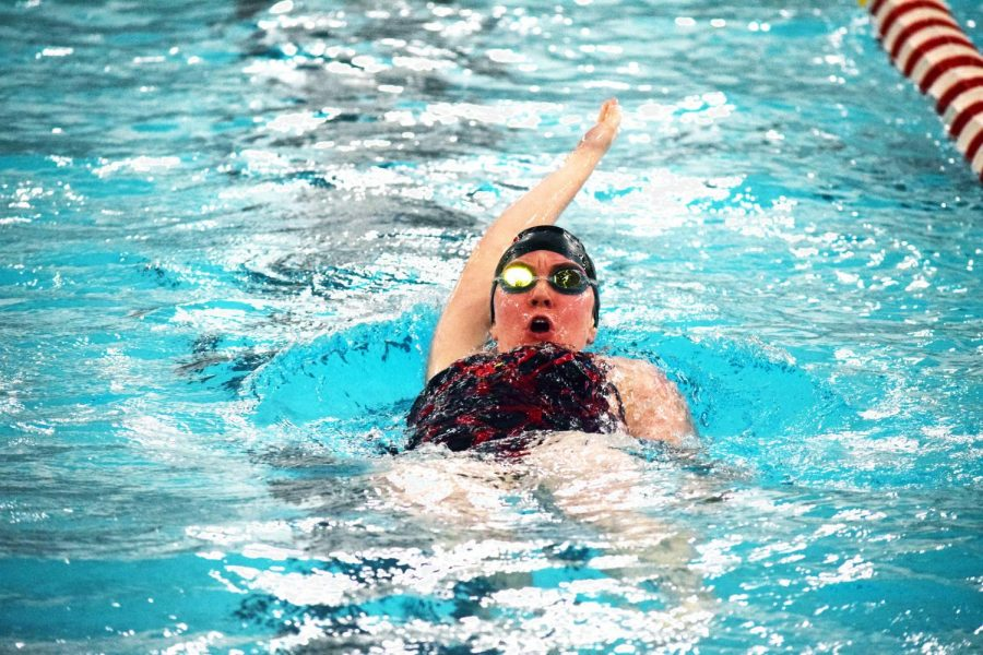 Senior Liz Lamkin swims backstroke for a portion of the Individual Medley Event in this past 2017-18 season. She states that she is excited to take on this upcoming season with her teammates.