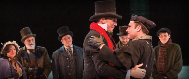 Ebenezer Scrooge embraces his nephew in the second act of a Christmas Carol.