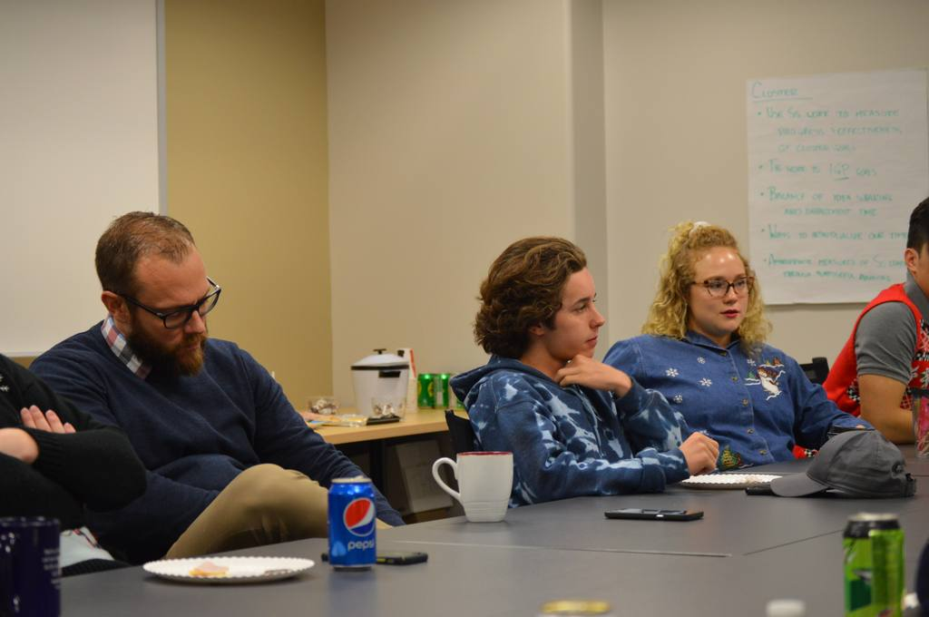 SHS principal Brian Knight, junior Layne DeHart and senior Jadin Benge sit in one of their student leadership meetings. The group of students and administration meet monthly.