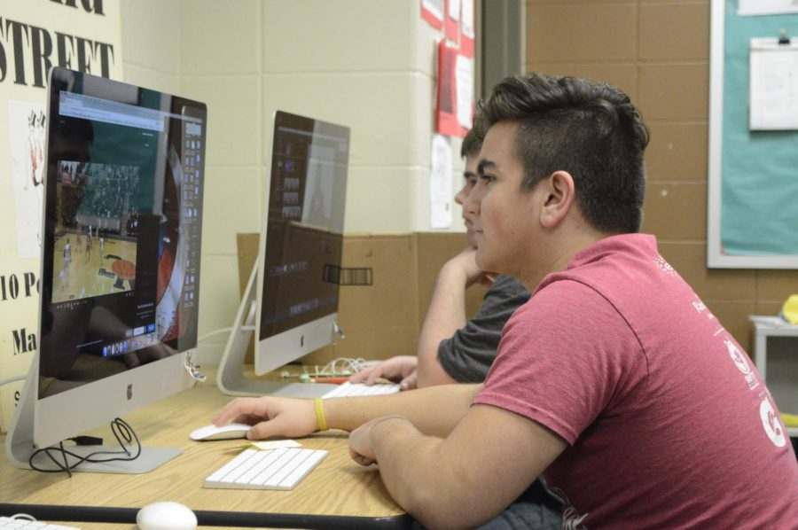 Junior Matthew Tellas works on a basketball video during the mass media period, RW2.
