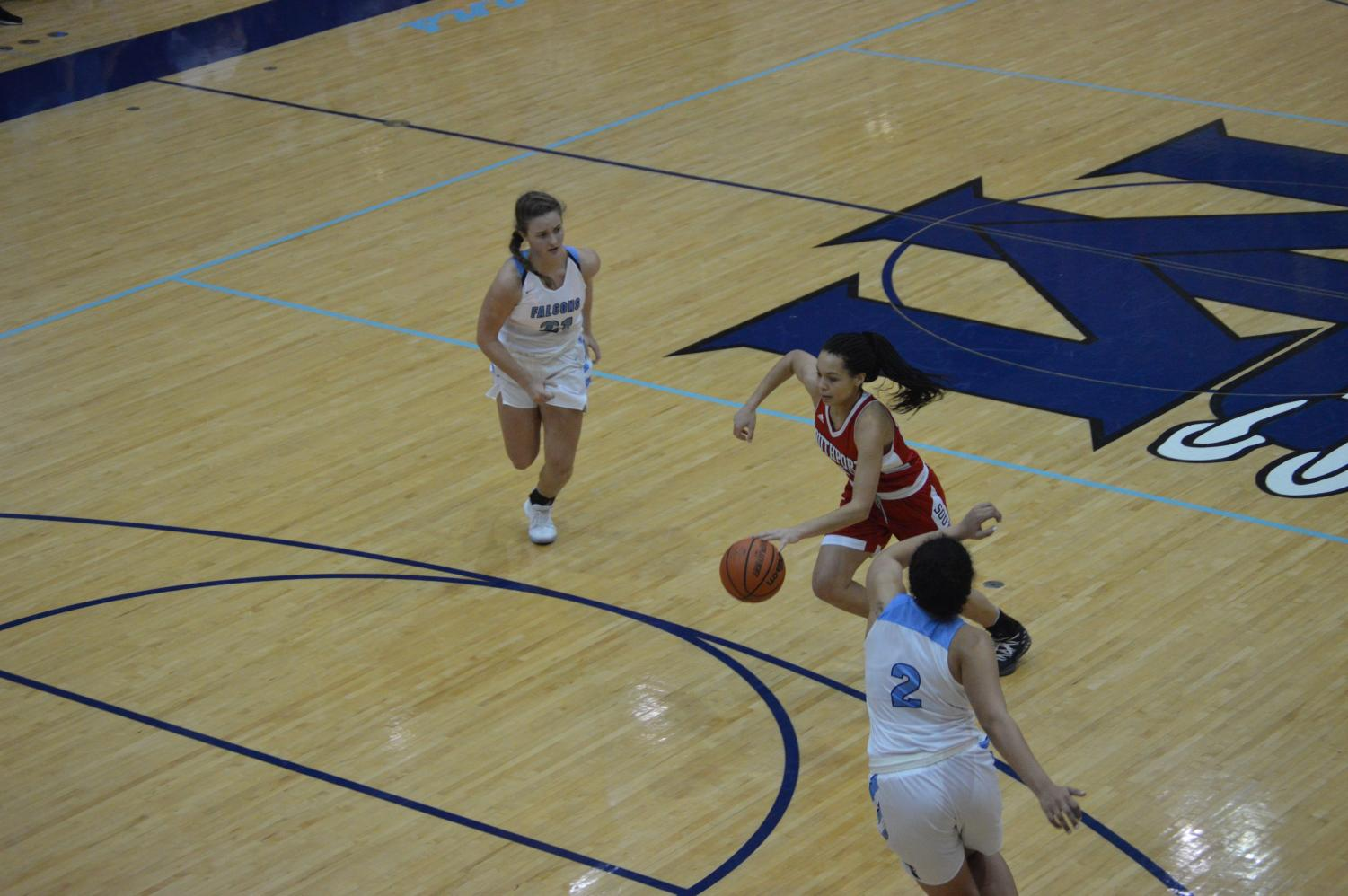 Sophomore Kyra Duncan dribbles through the Perry Meridian defense on Jan. 19.
