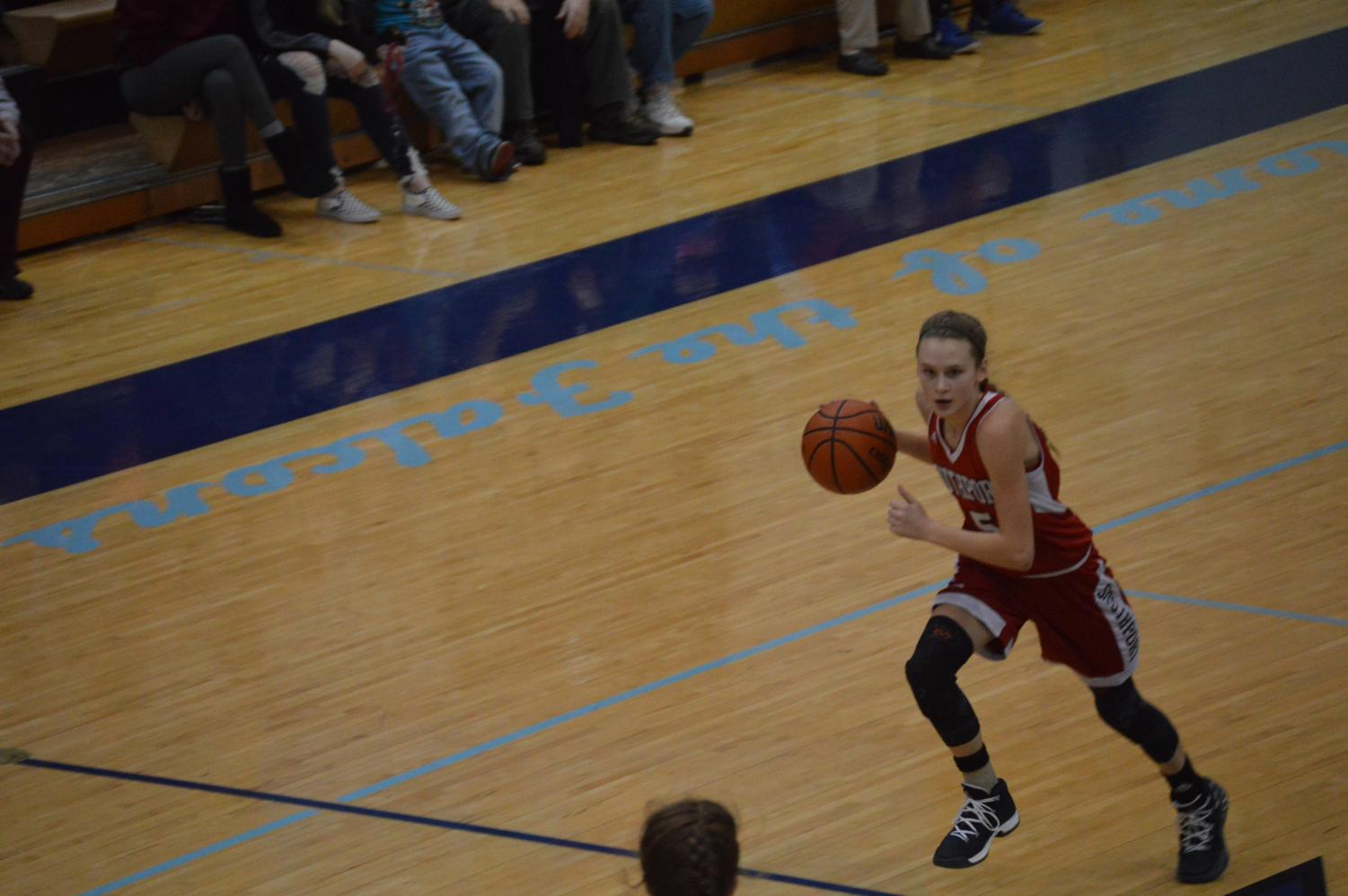 Sophomore Lexie Green dribbles against the Perry Meridian defense on Jan. 19. SHS lost in a last second shot.