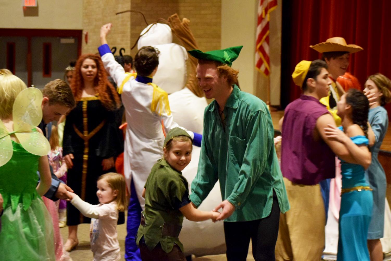 Senior Brenden Coomler waltzes with a girl that's dressed as the Disney character Peter Pan during Tea With a Princess on Sunday Feb. 4. Coomler played the role as Peter Pan as well.