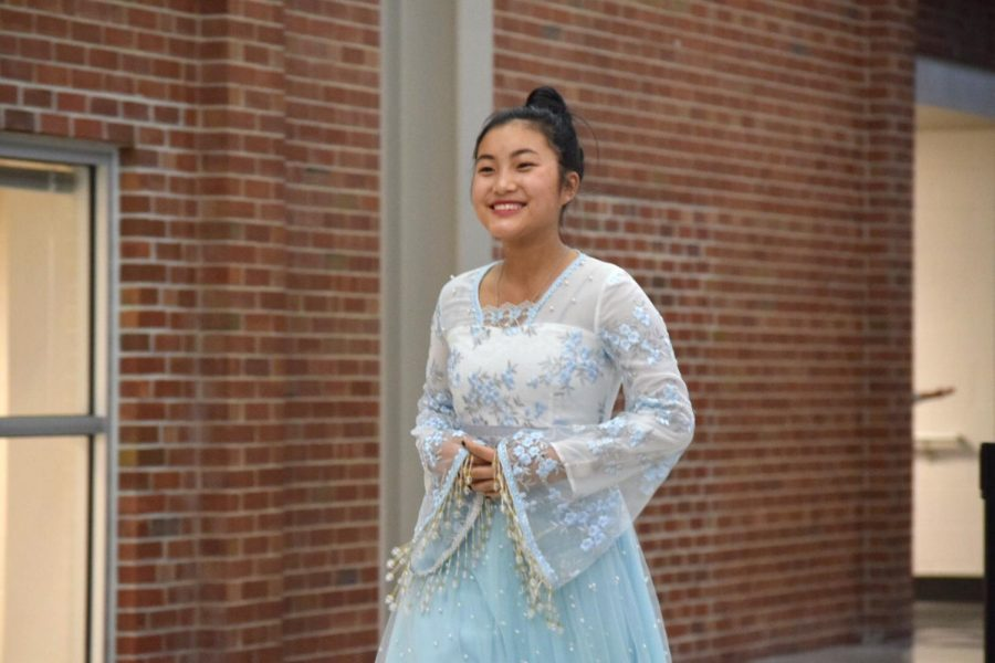 Sophomore Iang Tial smiles for the audience during the fashion portion of the celebration.