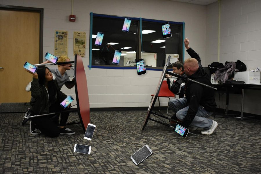Various members of the Samsung Syndicate (left) and the iPhone Clan (right)  are caught in a scuffle right after school.