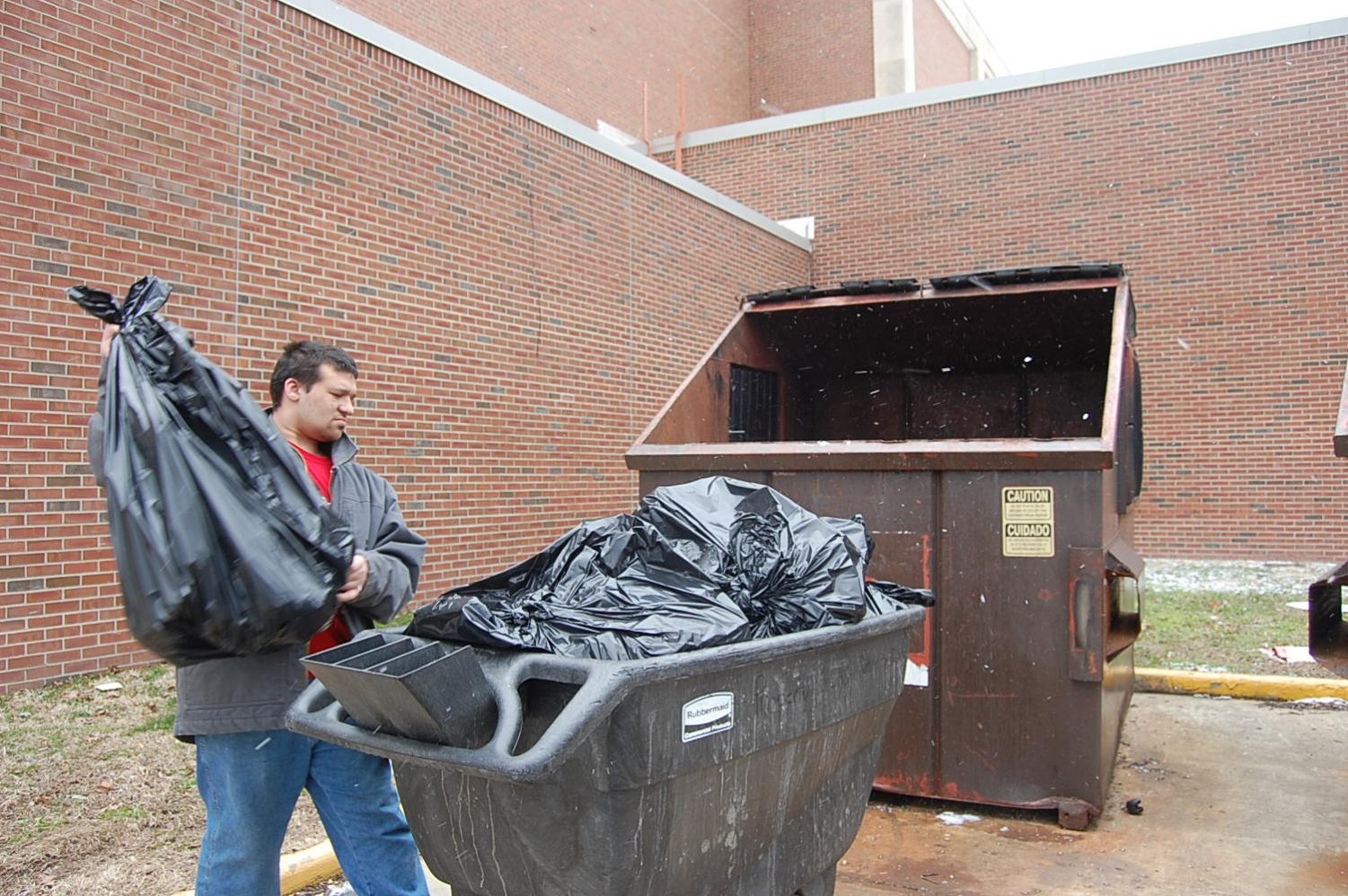 Junior Daniel McDonald takes out the trash during second lunch on Thursday, March 8.