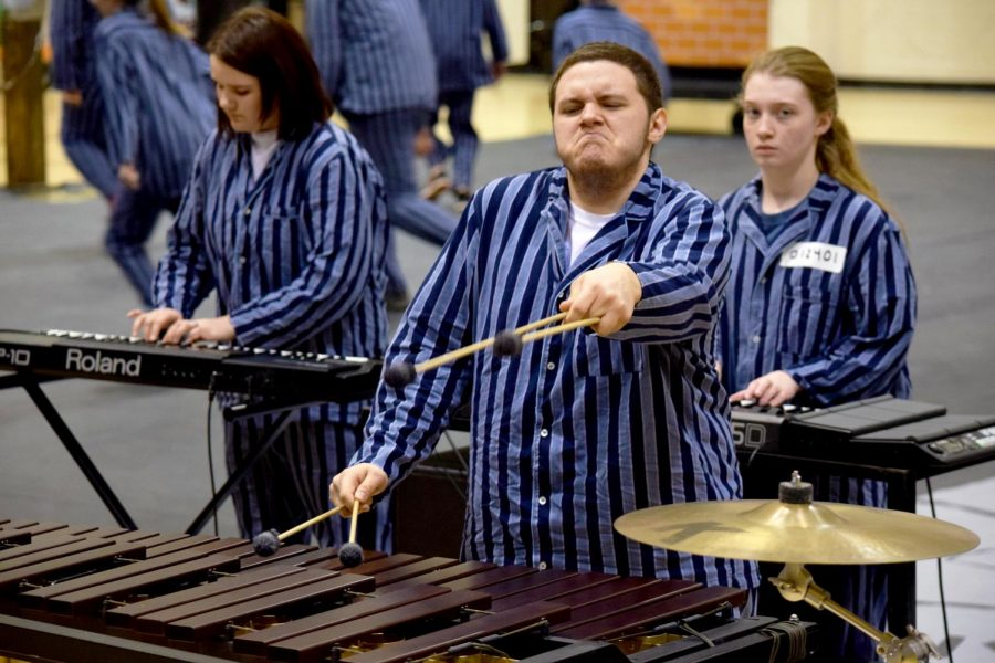 Senior Ignacio Rodriguez acts and plays the marimba during the winter drumline showcase on Friday, March 2.