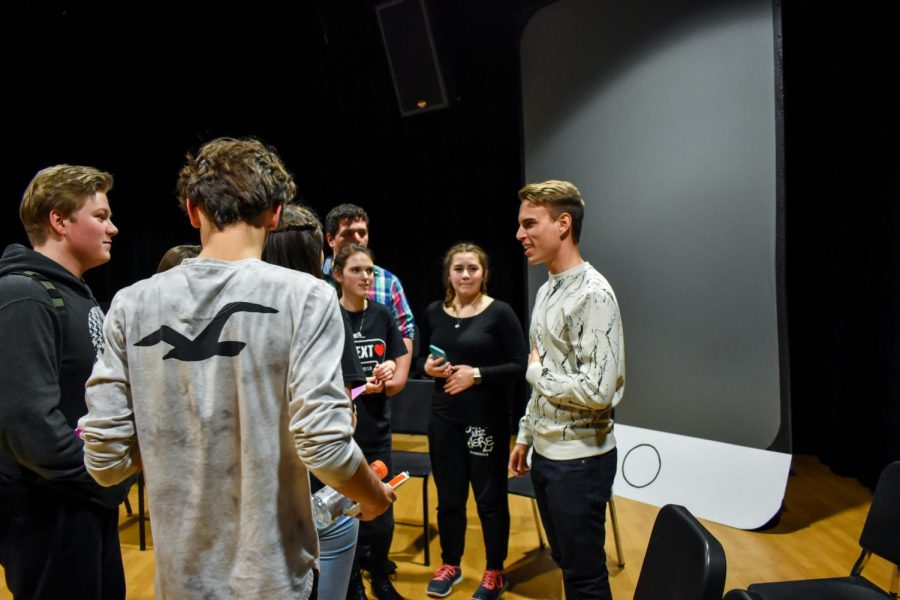 Playwright Tyler Dwiggins meets with a few members of the cast and crew of subText after his Q&A session.