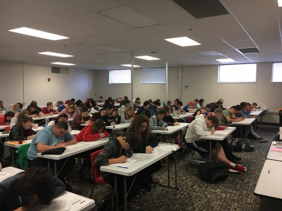 AP Language students take a mock exam. Because AP exams are approaching, many AP teachers are having their students prepare for the exam by studying and giving mock exams.