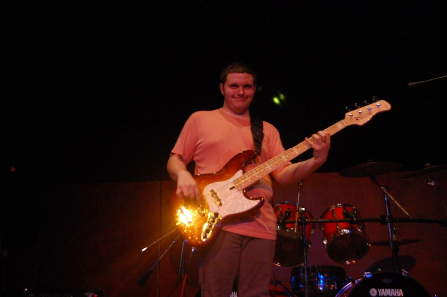 """Senior Ignacio Rodriguez plays the electric bass for his band on stage. He has played the electric bass for other events in school such as Jazz Band and the musical """"The Little Mermaid."""""""