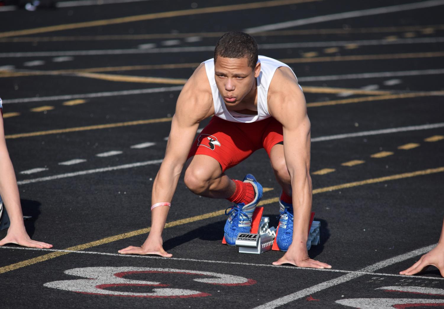 Junior Antwuan Payne prepares for the men's 100 meter dash on Wednesday, April 11.
