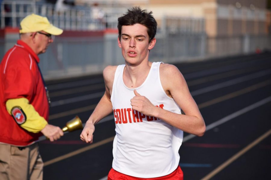 Senior Michael Crook takes the lead during the mens 1600 meter run.