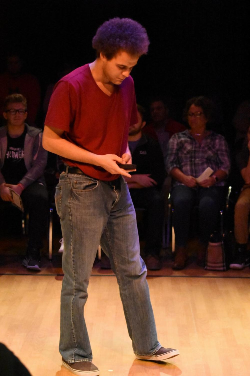 Senior Ryan Pennington texts on his phone during the production of subText.