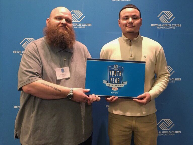 Mid-year graduate Jonathan Rodriguez (right) won the Youth of the Year award. He gives credit to his mother, the Boys and Girls Club and their staff.